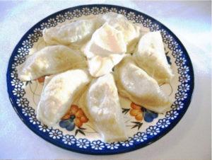 Pierogi with sour cream
